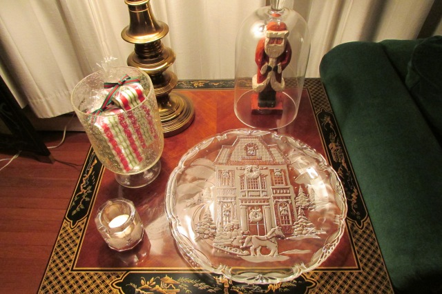 A grouping of glass items on an end table.