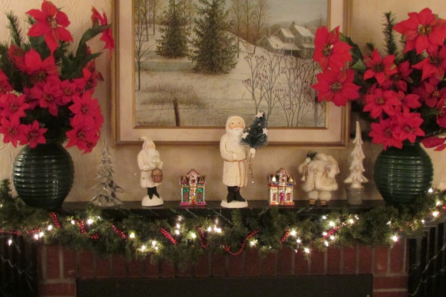 Some Chalk-ware Santas on the fireplace mantel.