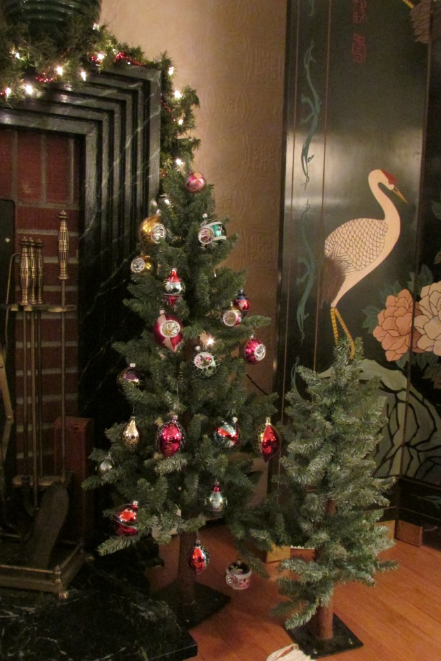 One of the two sets of small trees that flank the fireplace.