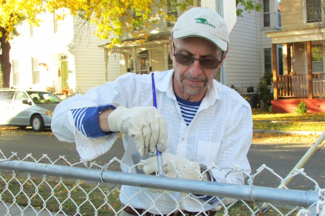 Here I am, painting the fence, at my Mother's house.