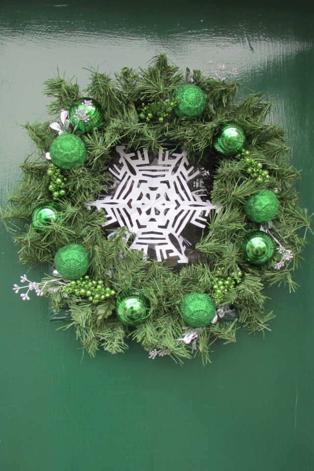 Christmas wreaths, that I've decorated, are hung on all the doors and windows.