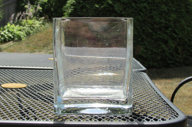 The square, clear glass vase that I used for pool water-loss testing.
