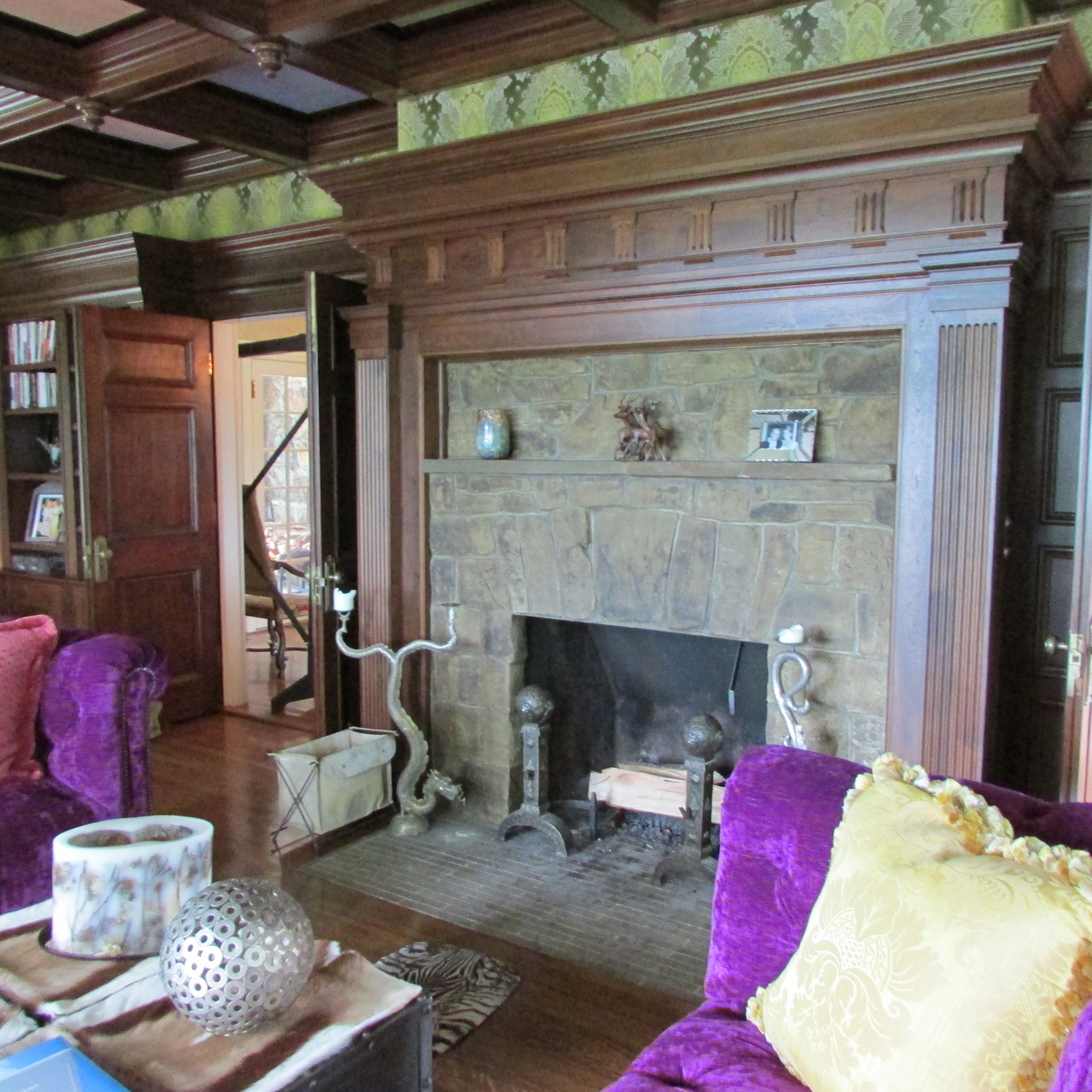 The Above Photo Shows The Fireplace Being Flanked By The Two Purple Sofas.  Notice How The Silver Color Of The Pierced Sphere, On The Boxes That Make  Up The ...